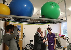 Prince Charles (known as The Duke of Rothesay when in Scotland) chats to staff during his visit to the Ayrshire Hospice in Ayr where he met patients and their families, staff and volunteers, with standing-volunteer occupational therapist George Bell (left) and patient Jim Fitzsimmons (centre right) and occupational therapist Joan Carrigan (right).