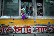 Passengers wait in congested traffic near Sadarghat Boat Terminal in Dhaka, Bangladesh.