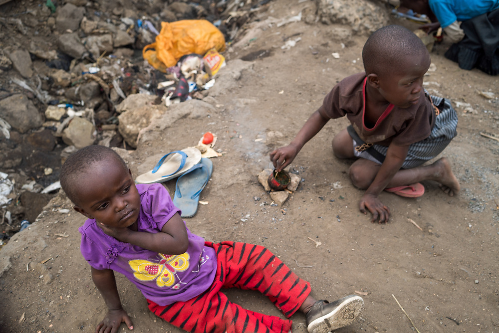 Two Children in Mathare by Millicent Lodenyi