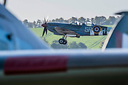 A two seater Spitfire takes off for a practice flight - Duxford Battle of Britain Air Show at the Imperial War Museum. Also commemorating the 50th anniversary of the 1969 Battle of Britain film. It runs on Saturday 21 & Sunday 22 September 2019
