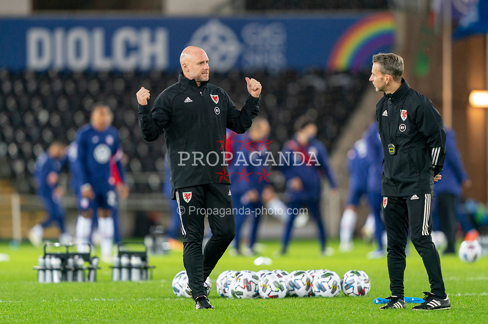 SWANSEA, WALES - Thursday, November 12, 2020: Wales' assistant coach Robert Page, who stands in for manager Ryan Giggs after he was arrested on suspicion of assault, and assistant coach Albert Stuivenberg (R) during the pre-match warm-up before an International Friendly match between Wales and the USA at the Liberty Stadium. (Pic by David Rawcliffe/Propaganda)
