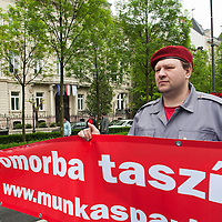 Supporters of the Hungarian Communist Party march in front of Hungarian Stock Exchange celebrating Labour Day in Budapest, Hungary on May 01, 2011. ATTILA VOLGYI