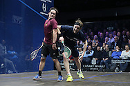 James Willstrop of England (wearing a Dark Blue shirt) collides into Paul Coll of New Zealand (wearing a Maroon shirt). Canary Wharf Squash Classic 2016 , day two at the East Wintergarden in Canary Wharf , London on Tuesday 8th March 2016.<br /> pic by John Patrick Fletcher, Andrew Orchard sports photography.