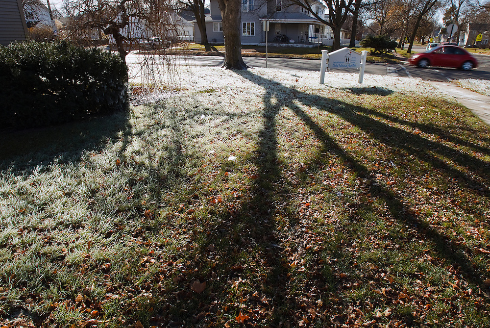 Heavily frosted parts of a lawn are illuminated by an afternoon sun Sunday outside the Central Nebraska Child Advocacy Center in Grand Island. Temperatures quickly dropped from Saturday evening's high 70s into Sunday morning's low 20s according to the National Weather Service in Hastings. (Independent/Matt Dixon)