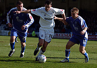 Photo: Olly Greenwood.<br />Gillingham v Huddersfield Town. Coca Cola League 1. 08/04/2006. Huddersfield's Danny Schofield tries to get past Gillingham's Alan Pouton and Danny Jackman.
