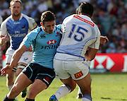 Brendan McKibbin with a big hit on Alfi Mafi. Waratahs v Force. 2013 Investec Super Rugby Season. Allianz Stadium, Sydney. Sunday 31 March 2013. Photo: Clay Cross / photosport.co.nz