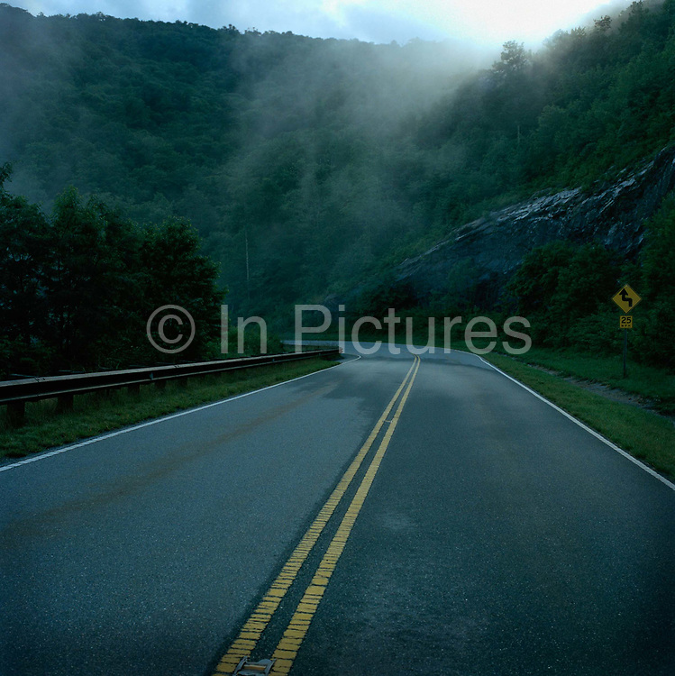 The famous Blue Ridge Parkway, a breathtaking highway through the Appalacian Mountains. This was shot in The Great Smoky Mountain Park near Robbinsville NC, taken as part of a 2700 mile two week road trip from Atlanta Georgia through Tennessee and Mississippi to New Orleans. There is great feeling of  freedom when you know you have  two weeks away from work  and responsibility and nothing but open road before you.