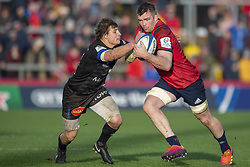 December 9, 2018 - Limerick, Ireland - Peter O'Mahony of Munster tackled by  Florian Vialelle of Castres during the Heineken Champions Cup Round 3 match between Munster Rugby and Castres Qlympique at Thomond Park Stadium in Limerick, Ireland on December 9, 2018  (Credit Image: © Andrew Surma/NurPhoto via ZUMA Press)
