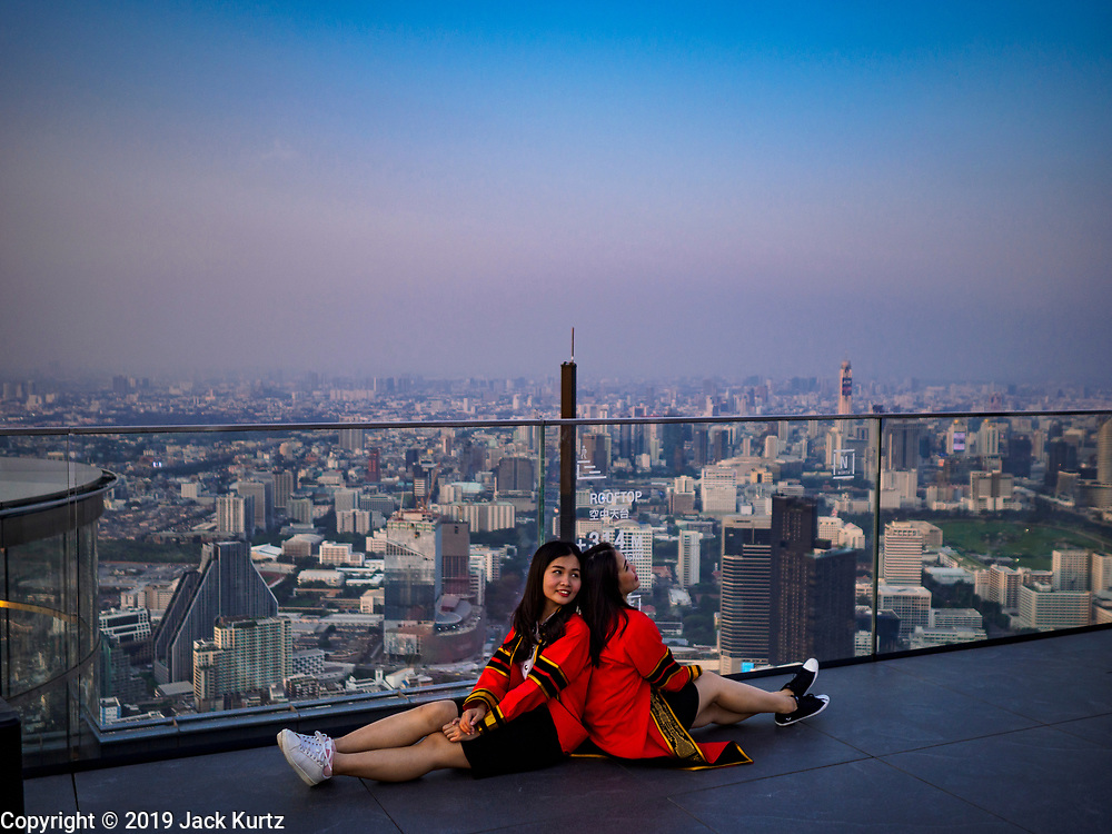 17 JANUARY 2019 - BANGKOK, THAILAND:  Bangkok as seen from the MahaNakhon Skywalk, at the top of the King Power Maha Nakhon Tower, is  1,030 feet (314 meters) above street level. It is the tallest building and highest vantage point in Bangkok. The skywalk opened in November and has been drawing large crowds.      PHOTO BY JACK KURTZ