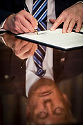 President Donald Trump signs one executive order and two presidential memoranda on tax and Wall Street regulations in Washington, District of Columbia, U.S., on Friday, April 21, 2017. This was President Trump's first visit to the Treasury Department.