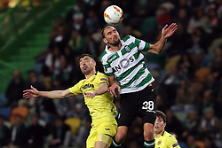 February 14, 2019 - Lisbon, Portugal - Sporting's forward Bas Dost from Holland (R ) vies with Villarreal's midfielder Javi Fuego during the UEFA Europa League Round of 32 First Leg football match Sporting CP vs Villarreal CF at Alvalade stadium in Lisbon, Portugal on February 14, 2019. (Credit Image: © Pedro Fiuza/NurPhoto via ZUMA Press)