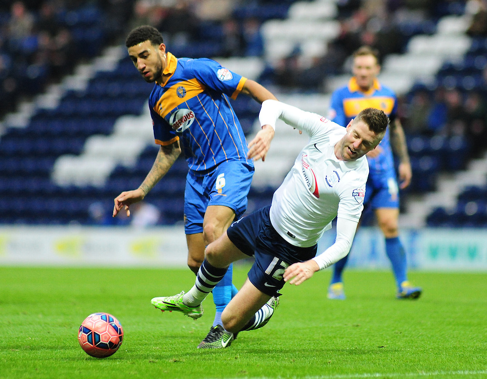 Preston North End's Paul Gallagher is challenged by Shrewsbury Town's Connor Goldson<br /> <br /> Photographer Andrew Vaughan/CameraSport<br /> <br /> Football - FA Challenge Cup Second Round - Preston North End v Shrewsbury Town - Saturday 6th December 2014 - Deepdale - Preston<br /> <br />  © CameraSport - 43 Linden Ave. Countesthorpe. Leicester. England. LE8 5PG - Tel: +44 (0) 116 277 4147 - admin@camerasport.com - www.camerasport.com