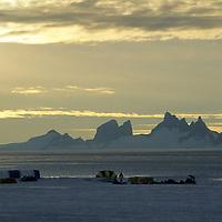 ANTARCTICA.  Blue One expedition base in Queen Maud Land. Fenris Mts. & Mt. Ulvetanna bkg.