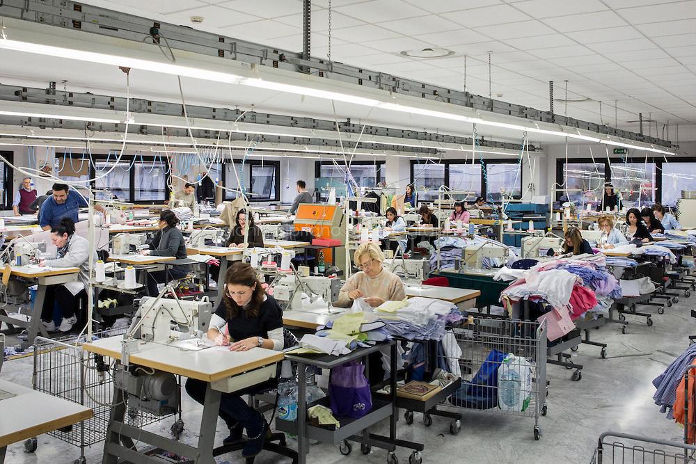 ARZANO, ITALY - 16 January 2014: Tailors sew shirts at the Kiton factory in Arzano, Italy, on January 16th 2014.