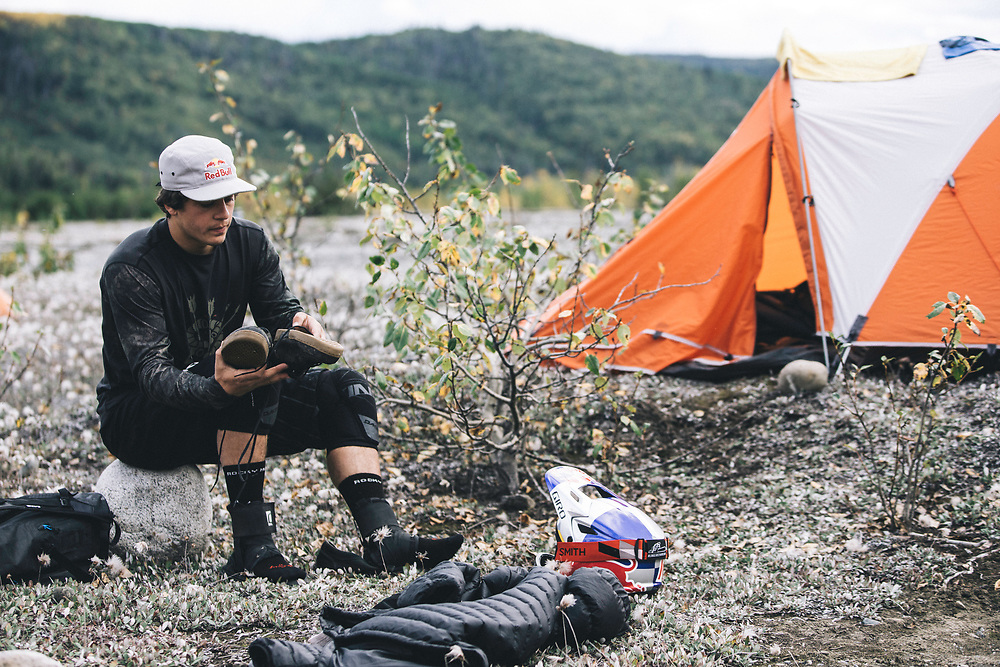 Carson Storch prepares for the following day while at camp in the Tatshenshini-Alsek Provincial Park in British Columbia, Canada on September 2, 2016.