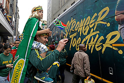 Monday 11th November 2019.<br /> City Hall, Grand Parade,<br /> And City Centre, Cape Town,<br /> Western Cape,<br /> South Africa.<br /> <br /> SPRINGBOKS CELEBRATE WINNING THE RUGBY WORLD CUP CHAMPIONSHIP IN 2019 WITH A COUNTRYWIDE VICTORY TOUR!<br /> <br /> SPRINGBOKS RUGBY WORLD CUP VICTORY TOUR CAPE TOWN!<br /> <br /> A young girl sits on top of her father's shoulders as they watch along with other excited fans as they celebrate the Springboks driving past in their open top bus in the Cape Town City Centre.<br /> <br /> The reigning Rugby World Cup Champions namely the South African Springbok Rugby Team, celebrates winning the Webb Ellis Cup during the International Rugby Football Board Rugby World Cup Championship held in Japan in 2019 with their Victory Tour that culminated in the final city tour taking place in Cape Town. Thousands of South African fans filled the streets of the city all trying their best to show their support for their beloved Springboks and to celebrate them winning the Rugby World Cup for the third time. South Africa previously won the Rugby World Cup in 1995, 2007 and now again in 2019. South African Springbok Captan Siya Kolisi took the opportunity to speak to the gathered crowd about how something like this brings unity and that we should live together as a nation that practices what is known as ubuntu. Ubuntu is a quality that includes the essential human virtues of compassion and humanity. This image taken in Cape Town on Monday 11th November 2019.<br /> <br /> This image is the property of Seven Bang Media Group (Pty) Ltd, hereinafter referred to as SBM.<br /> <br /> Picture By: SBM / Mark Wessels. (11/11/2019).<br /> +27 (0)61 547 2729<br /> mark@sevenbang.com<br /> www.sevnbang.com<br /> <br /> Copyright © SBM. All Rights Reserved.