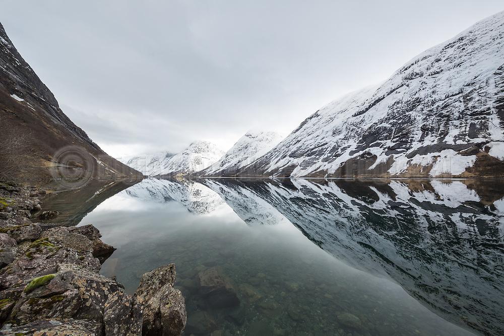 Norwegian fjord surrounded by snowy montains   Kjøsnesfjorden i Jølster kommune omringa av snødekte fjell.