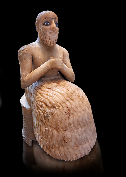 Gypsum, schist, shells and lapis lazuli statue of Ebih-Il, early Dynastic; Shakkanakku (military governor) of the ancient city-state of Mari in present day eastern Syria, dating from circa 2340 BC or from the Akkadian period of rule Circa 2250 BC.. The statue carries a cuneiform inscription in Akkadian. Excavated from; the temple of Ishtar at Mari by André Parrot in 1934-1935 the statue measures; 52.5 cm (20.7 in) high; 20.6 cm (8.1 in) wide and 30 cm (11.8 in) deep. Department of Oriental Antiquities; Richelieu; ground floor; room 1b; inv AO 17551; Louvre Museum; Paris .<br /> <br /> Ebih-Ils head is shaved. His long beard is composed of vertical curls and has holes drilled, and was formerly inlaid with another, now-lost material. The beard accentuates the figure's cheeks and finely sculpted lips that convey a half-smile. The figure's staring blue eyes were crafted with particular care and attention to detail. A combination of schist, shells and lapis lazuli was used to depict the eyelashes and eyelids, cornea and iris, respectively. The lapis lazuli inlays used were imported from as far east as Afghanistan.<br /> <br /> Visit our ANCIENT WORLD PHOTO COLLECTIONS for more photos to download or buy as wall art prints https://funkystock.photoshelter.com/gallery-collection/Ancient-World-Art-Antiquities-Historic-Sites-Pictures-Images-of/C00006u26yqSkDOM<br /> <br /> If you prefer to buy from our ALAMY PHOTO LIBRARY  Collection visit : https://www.alamy.com/portfolio/paul-williams-funkystock  Type -    Louvre Mari   - into the LOWER SEARCH WITHIN GALLERY box