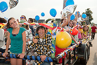 """The freshman class flew through Church Street on their """"Space"""" themed float during the LHS Homecoming Parade Friday afternoon.  (Karen Bobotas/for the Laconia Daily Sun)"""