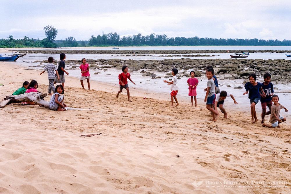 Kalimantan, Tanjung Datu. Small village close to the Malaysian border. Children playing on the beach.