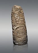 Late European Neolithic prehistoric Menhir standing stone with carvings on its face side. The representation of a stylalised male figure starts at the top with a long nose from which 2 eyebrows arch around the top of the stone. below this is a carving of a falling figure with head at the bottom and 2 curved arms encircling a body above. Excavated from Paule Luturru,  Samugheo. Menhir Museum, Museo della Statuaria Prehistorica in Sardegna, Museum of Prehoistoric Sardinian Statues, Palazzo Aymerich, Laconi, Sardinia, Italy. Grey background. .<br /> <br /> Visit our PREHISTORIC PLACES PHOTO COLLECTIONS for more photos to download or buy as prints https://funkystock.photoshelter.com/gallery-collection/Prehistoric-Neolithic-Sites-Art-Artefacts-Pictures-Photos/C0000tfxw63zrUT4
