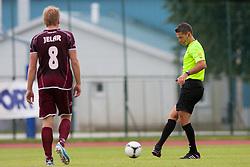 Jelar Anze of NK Triglav & fifa referee Damir Skomina during football match between NK Triglav Kranj and Aluminij 2nd Round of Prva Liga, on 22 July, 2012, in Sportni center, Kranj, Slovenia. (Photo by Grega Valancic / Sportida)