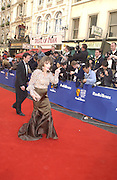 Joan Collins and Percy Gibson. TV Bafta Awards. 21 April 2002. © Copyright Photograph by Dafydd Jones 66 Stockwell Park Rd. London SW9 0DA Tel 020 7733 0108 www.dafjones.com