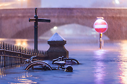 © Licensed to London News Pictures. 08/02/2021. York UK. Bikes sit in flood water as it begins to snow in York city centre this morning while Storm Darcy continues to batter the uk. Photo credit: Andrew McCaren/LNP