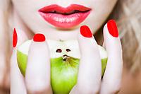 beautiful caucasian woman portrait showing an apple studio