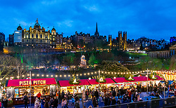 View of Edinburgh Christmas Market in west Princes Street gardens and skyline of the city towards the Old town in Edinburgh, Scotland, UK