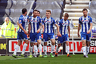 Chris McCann of Wigan Athletic (2nd left) celebrates with his teammates after scoring his teams 1st goal. Skybet football league one match , Wigan Athletic v Southend Utd at the DW Stadium in Wigan, Lancs on Saturday 23rd April 2016.<br /> pic by Chris Stading, Andrew Orchard sports photography.