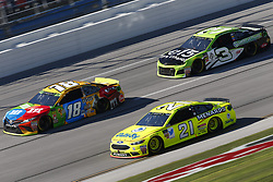 October 14, 2018 - Talladega, Alabama, United States of America - Kyle Busch (18) battles for position during the 1000Bulbs.com 500 at Talladega Superspeedway in Talladega, Alabama. (Credit Image: © Justin R. Noe Asp Inc/ASP via ZUMA Wire)
