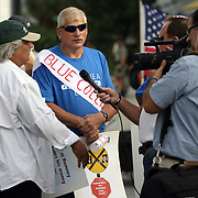 Media members interview marchers during a parade prior to the Republican National Convention in Tampa, Fla. on Wednesday, August 29, 2012. (AP Photo/Alex Menendez)