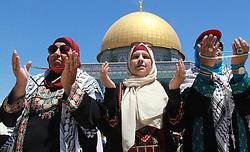 June 16, 2017 - Jerusalem, Jerusalem, Palestinian Territory - Palestinian Muslim worshippers attend the third Friday prayers of the Muslim holy month of Ramadan at Jerusalem's al-Aqsa mosque compound on June 16, 2017  (Credit Image: © Mahfouz Abu Turk/APA Images via ZUMA Wire)