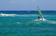 A man rides the wind off Oahu, Hawaii