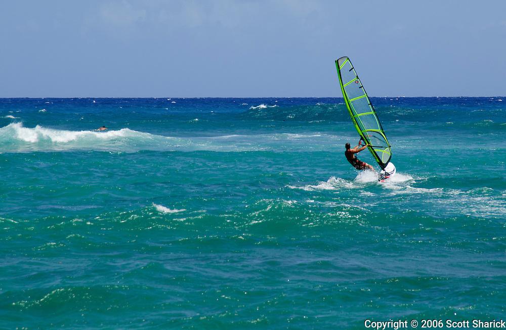 A man rides the wind off Oahu, Hawaii