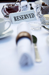 Close up of breakfast table with napkins and reserved sign