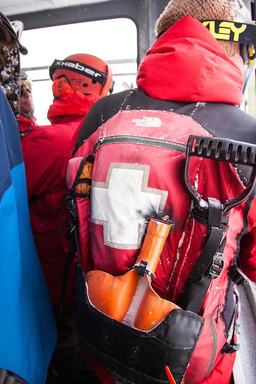 The ski patrol uniform on the tram at Snowbird.