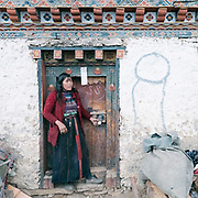 Fertility symbol on the door. Life at Mr and Ms Wangchuk's house on the edge of the Laya village.