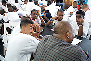 Bennie Fowler of Ford speaks with children at the 2013 Steve Harvey Mentoring Weekend outside of Dallas.