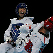 Sebastien Michaud, Canada, (red) in action against Arman Yeremyan, Armenia, (blue) during the Taekwondo Men 80kg competition during the London 2012 Olympic games. London, UK. 10th August 2012.