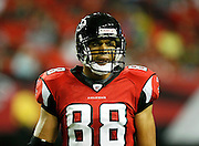 ATLANTA - AUGUST 29:  Tight end Tony Gonzalez #88 of the Atlanta Falcons takes a breather during pre-game warmups before the game against the San Diego Chargers at the Georgia Dome on August 29, 2009 in Atlanta, Georgia.  The Falcons beat the Chargers 27-24.  (Photo by Mike Zarrilli/Getty Images)