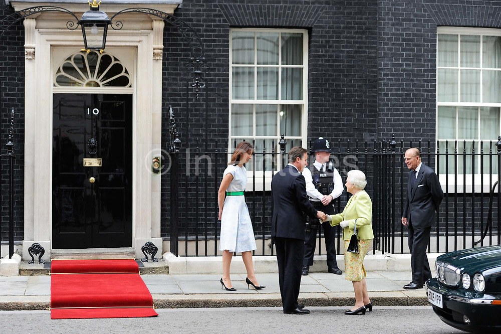 Britain's Prince Philip and Queen Elizabeth line up for a photograph with Prime Minister David Cameron and his wife Samantha before a lunch to celebrate the Prince's 90th birthday at number 10 Downing Street in London.
