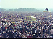 """Pope John-Paul II visits Ireland..1979..29.09.1979..09.29.1979..29th September 1979..Today marked the historic arrival of Pope John-Paul II to Ireland. He is here on a three day visit to the country with a packed itinerary. He will celebrate mass today at a specially built altar in the Phoenix Park in Dublin. From Dublin he will travel to Drogheda by cavalcade. On the 30th he will host a youth rally in Galway and on the 1st Oct he will host a mass in Limerick prior to his departure from Shannon Airport to the U.S..An Image taken of the massive congregation,estimated at 1.25million who attended the mass in the Phoenix Park. The """"Popemobile"""" makes its appearance so that the Pope can move among the crowds."""