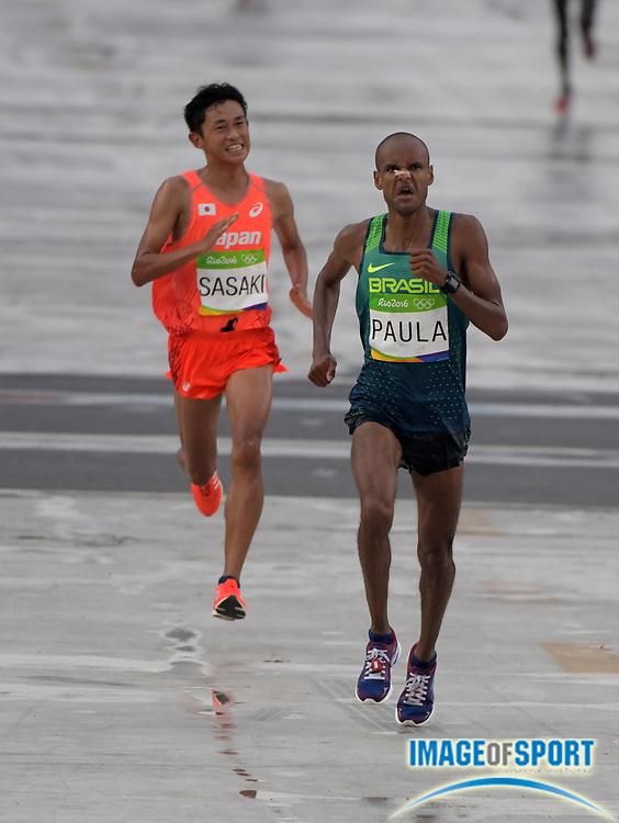 Aug 21, 2016; Rio de Janeiro, Brazil; Paulo Roberto Paula (BRA) and Satoru Sasaki (JPN) place 15th and 16th in 2:13:56 and 2:13:57 in the marathon during the Rio 2016 Summer Olympic Games at Sambodromo.