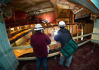 Jared Guilmett and Rob Turpin from Misiaszek & Turpin Architects take measurements inside the upper right balcony box in the Colonial Theater as the remaining steel joists are removed on Wednesday morning.  (Karen Bobotas/for the Laconia Daily Sun)