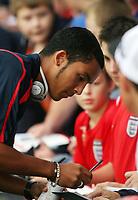 Photo: Chris Ratcliffe.<br /> England U21 v Moldova U21. European Championship Qualifier. 15/08/2006.<br /> Theo Walcott of England U21 signs autographs before the game.