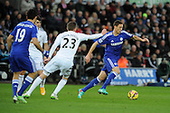 Nemanja Matic of Chelsea breaks away from Gylfi Sigurdsson of Swansea. Barclays Premier League match, Swansea city v Chelsea at the Liberty Stadium in Swansea, South Wales on Saturday 17th Jan 2015.<br /> pic by Andrew Orchard, Andrew Orchard sports photography.