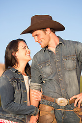 cowboy and a girl laughing together