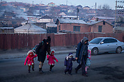 Parents bring their children to a kindergarten in one of the polluted ger districts of the city, January 21, 2019. The ger districts of the city are among the most polluted areas of the city as most residents burn raw cold to keep warm in the winter months.